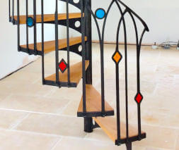 metal spiral stairs with tinted glass